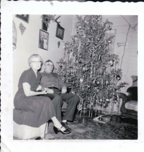 """Auntie"" & Frank in front of their Christmas tree."